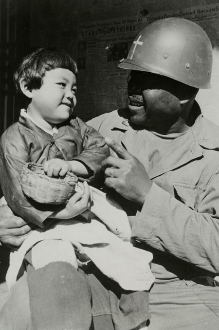 Korean War Chaplain with Korean child
