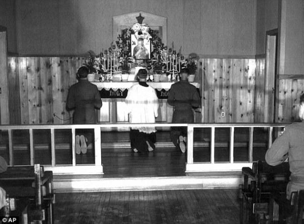 Chaplain (CPT) Emil Kapaun (center) celebrates Mass at Herrington Army Air Base, 1942.