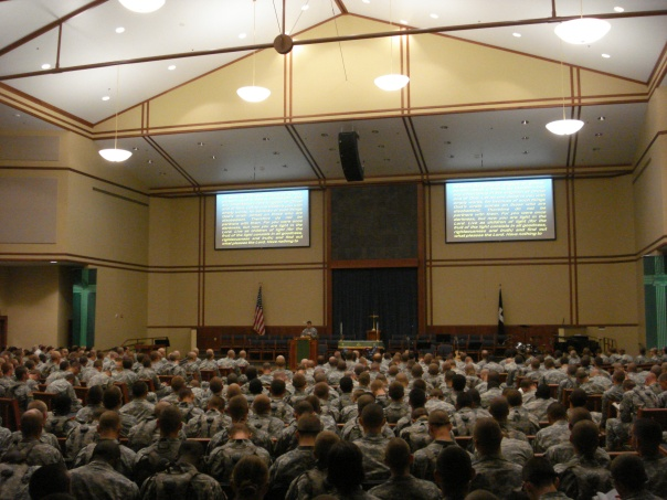 Chaplain (CPT) XXX XXXX conducting worship service for trainees of the 1st EN BDE at the new Main Post Chapel at Fort Leonard Wood, 4 Sep 2011.